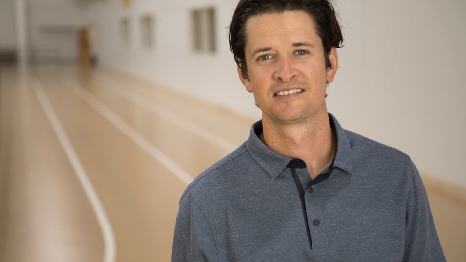 Portrait of Lucas Carr on an indoor track.